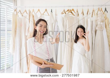 Portrait Of Happy Woman Holding Credit Card In Wedding Dress Store Owner,beautiful Successful Dressm