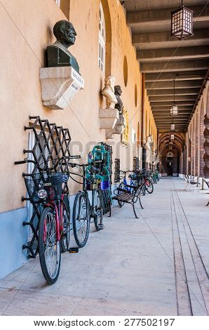 Szeged, Hungary - June 18, 2013: Bicycles, Sculptures, Benches Standing In A Long Outdoor Pantheon C