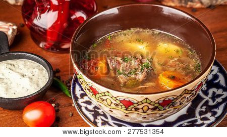 Traditional Uzbek Oriental Cuisine. Soup With Lamb Meat. Copy Space, Selective Focus