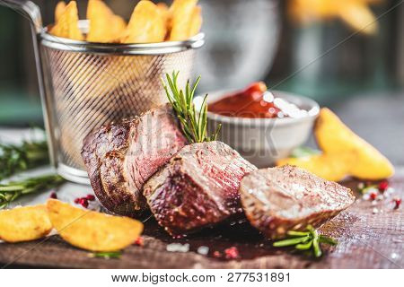 Healthy Lean Grilled Medium-rare Beef Steak And Vegetables With Roasted Potatoes.