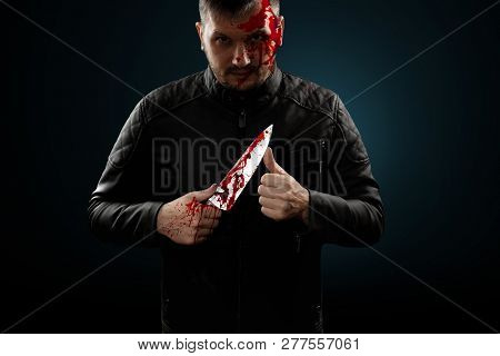A Serial Killer, A Maniac With A Knife And Splashes Of Blood. Halloween Concept, Psychopath. Copy Sp
