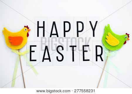 Close Up Of Happy Easter Greetings And Decorative Chicks Over White Background