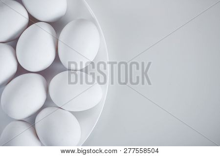 Close Up Top View Of Eggs Over White Table Background