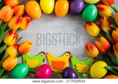 Easter Frame Background - Close Up Of Colorful Eggs, Decorative Chicks And Tulip Flowers