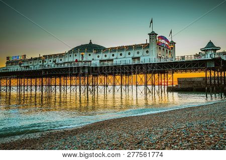 Brighton Pier Beach With Sunset Golden Hour At Sussex England, Uk. Brighton Marine Palace And Pier P