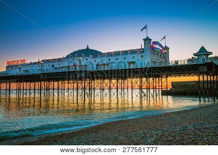 Brighton, England-19 October, 2018: Brighton Pier Beach With Sunset Golden Hour At Sussex England, U