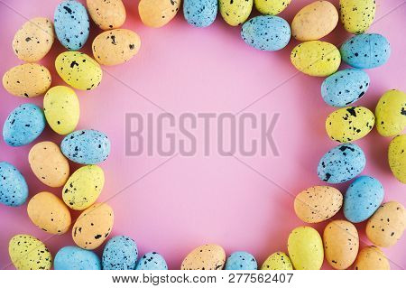 Easter Holiday Concept. Multicolored Miniature Eggs Close-up On A Pink Background. Miniature Eggs An