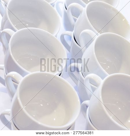 Empty White Cups Stacked On The Table. Tea Or Coffee Catering Services At The Hotel, Event, Conferen