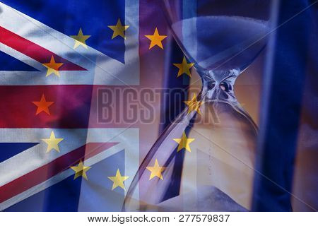 Closeup Elegant Sandglass Counting Down Time To Brexit On Background Of Overlapped Flags Of Great Br