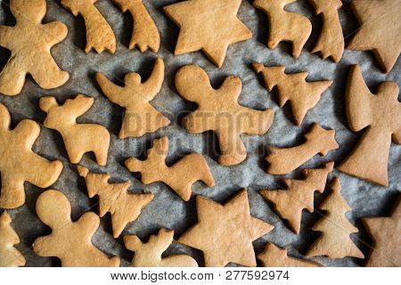 Close Up Top View Of Cookies Or Gingerbreads On The Baking Paper