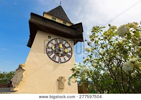 Clock tower, called the Uhrturm on top of Schlossberg Castle Hill in Graz, summer in Austria, Europe