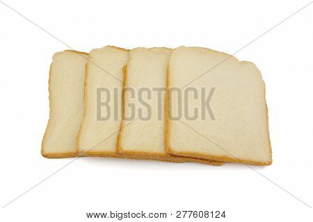 Close-up Of Slices Of Toast Bread Isolated On White Background. Close-up Of Fresh Toast Slices. Four