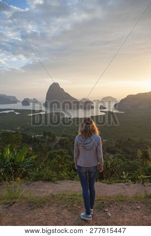 Young Woman Traveler   Relaxing And Enjoying A Beautiful Nature During Vacation .