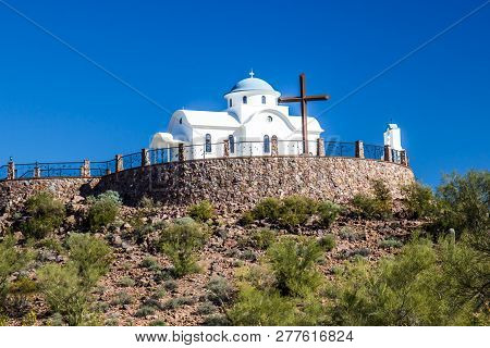 Monastery Chapel And Cross On Hilltop In Desert