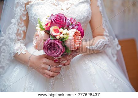 Bride On Nature With A Bouquet Of Peonies. Bouquet In The Hands Of The Bride . The Bride Holds A Bou
