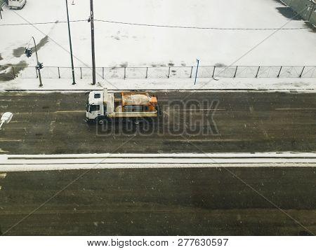 Salt Spreader Vehicle Sprinkles Salt In Thessaloniki, Greece.a Winter Service Salt Truck Vehicle Of