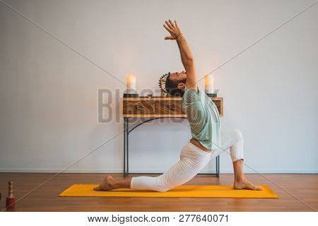 Yoga. Young Man Doing Yoga Exercise.
