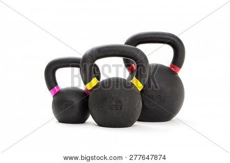 Three kettlebell weights on white background