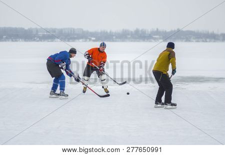 Dnipro, Ukraine - January 28, 2018: Group Of Different Aged People Playing Hokey On An Iced River Dn