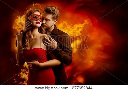 Couple Hot Flaming Kiss, Man In Love Kissing Seductive Dreaming Woman In Fantasy Red Sexy Mask