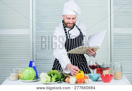Book Family Recipes. Ultimate Cooking Guide For Beginners. According To Recipe. Man Bearded Chef Coo