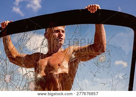 Dominated By His Ambition. Strong Man Hold Cracked Glass. Achieving Sport Ambition With Right Workou