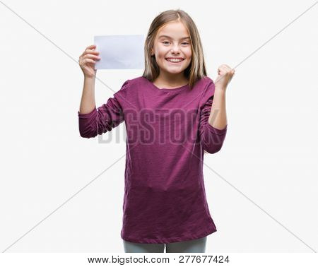 Young beautiful girl holding blank paper card over isolated background screaming proud and celebrating victory and success very excited, cheering emotion