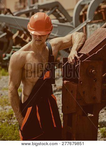 Construction Worker Concept. Construction Worker Rest At Heavy Machinery. Construction Worker In Wor