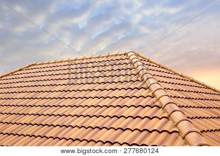 Roof Tiles And Sky Sunlight.roofing Contractors Concept Installing House Roof.
