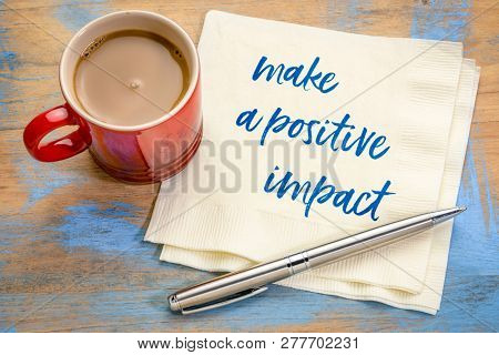 make a positive impact - handwriting on a napkin with a cup of coffee