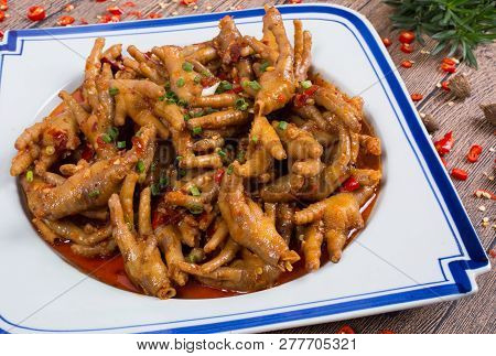 Spicy Chicken Feet In A Ceramic Dish