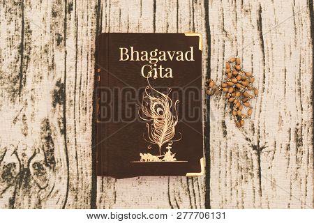 Maski,karnataka,india - December 29,2018 : Holy Bhagavad Gita With Wooden Textured Bckground