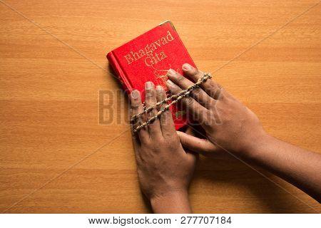 Maski,karnataka,india - December 29,2018  Holding Bhagavad Gita With Hands