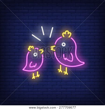 Couple Of Birds Neon Sign. Two Pink Birds With Yellow Crest Twittering To Each Other On Brick Wall B