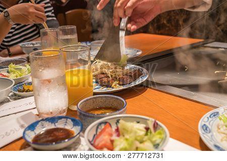 Serving Stir Fried Bean Sprout With Kobe Beef Steak In Japanese Restaurant