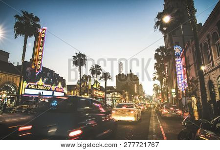 Los Angeles - March 20, 2015: Hollywood Boulevard At Sunset Twilight With Blurred Cars Light Tracks