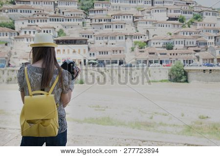 Woman Looking At Old Town Berati, Windows In Berat - Also Called City Of A Thousand Windows. Albania