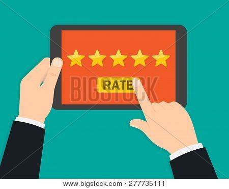Hand Holding And Pointing To A Tablet With Five Star On The Screen. Rating And Review. Customer Revi