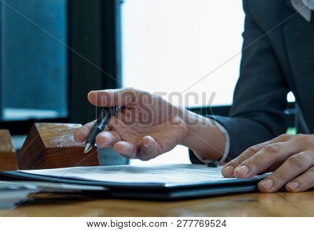 Concept Agreement,businessmen Holding A Pen, Signing A Document Agreement Withcustomer To Sign The C