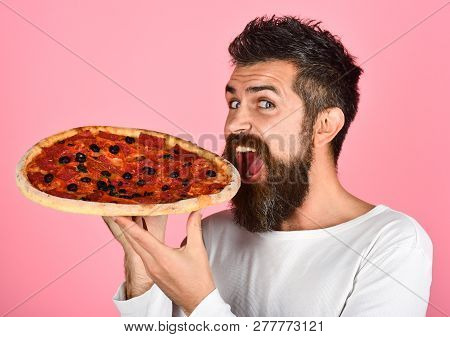 Hungry Man Eating Tasty Pizza. Satisfied Man With Beard And Mustache Enjoying Delicious Pizza. Fast
