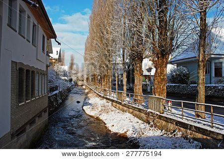 Alley Next To The Lyssbach River, A Small Brook Passing The City Center Of Lyss, Switzerland. Winter