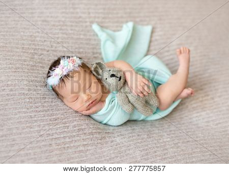 Cute sleeping newborn baby girl