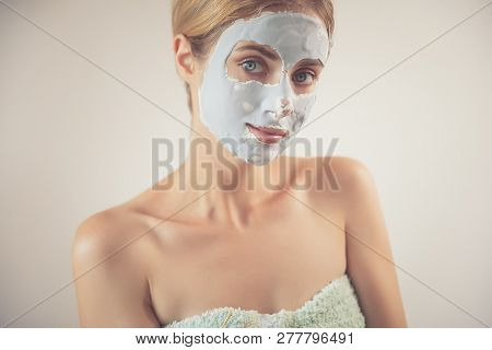 attractive caucasian woman applying alginate antiaging mask to face poster