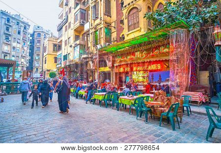 Cairo, Egypt - December 20, 2017: The Open Terraces Of Traditional Egyptian Food Cafes On The Street
