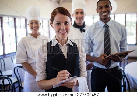Group of hotel staffs standing together in hotel