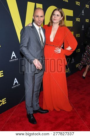 LOS ANGELES - DEC 11:  Sam Rockwell and Amy Adams arrives to