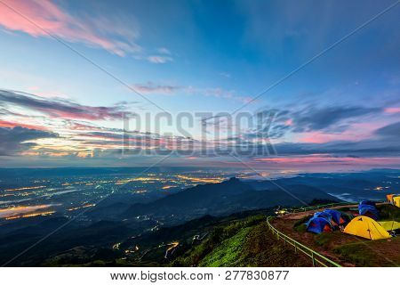 High View Beautiful Nature Landscape Of Colorful Sky During The Sunrise, See The Lights Of The Road