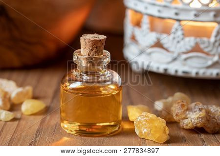 A Bottle Of Essential Oil With Frankincense Resin