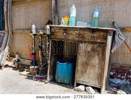 The Set Of Hookahs And Other Dirty And Old Items At The Egyptian Cafe. Unsanitary Conditions