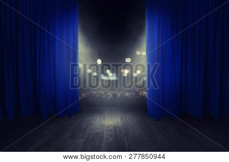 The Blue Curtains Are Opening For The Theater Show